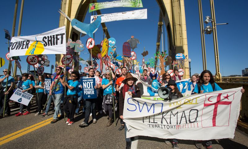 Young people march across a bridge in Pittsburgh as part of PS2013.